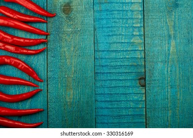fresh red chili pepper on old blue wooden background