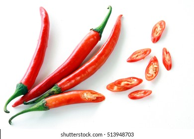 Fresh red chilli delicious savory slices on a white background.