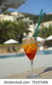 Fresh red colored cocktail near swimming pool, Summer