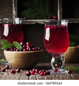 Fresh red cranberry juice on the vintage table, selective table and square image