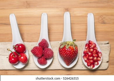 Fresh red fruit in rustic wooden background