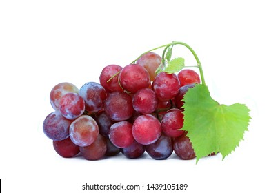 Fresh red grape with leaves isolated on white background
