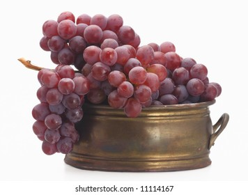 fresh red grape old  brassy tub isolated