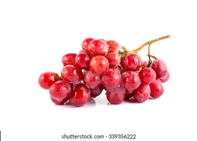Fresh red grape on white background.