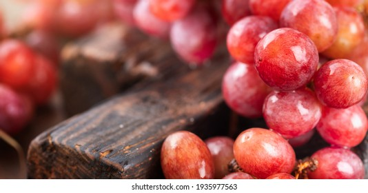 Fresh red grapes close up. Copy space