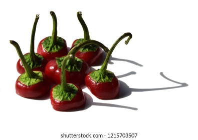 Fresh Red Hot Chile Peppers peperoni with shadow Isolated on a white background. Red chili or chilli cayenne pepper Clipping Path fun funny Flame Fire