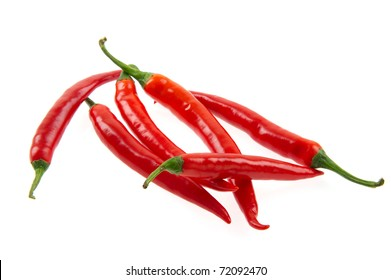 Fresh red hot chili peppers isolated over white