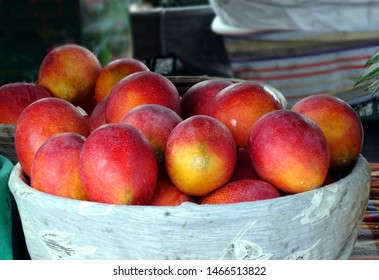 Fresh red Irwin mangoes for sale at an outdoor market