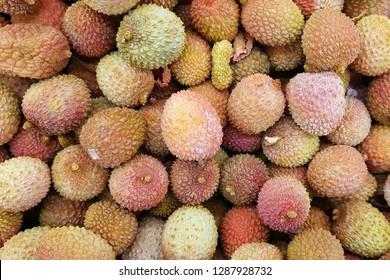 Fresh red litchi, lichee, lychee, or lichi, Litchi chinensis background. Close up photography