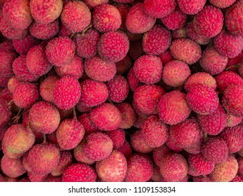 Fresh red lychee fruits background.
