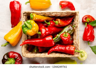 Fresh red paprika in box, vegetables above