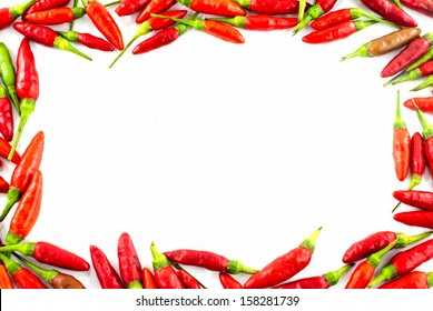 Fresh red pepper border on white background