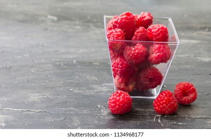 Fresh red raspberry on the wooden table