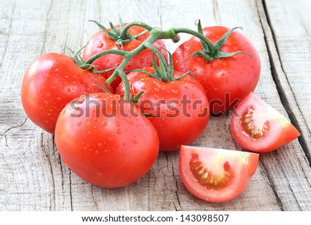 Fresh red ripe salad tomatoes on the vine