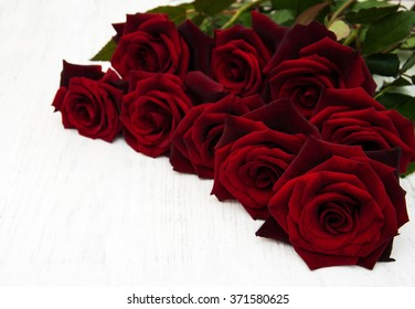 Fresh Red roses on a old wooden background
