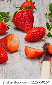 Fresh red strawberries on wooden table