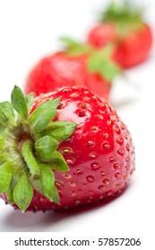 Fresh red strawberries over white