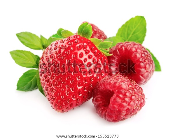 Fresh red strawberries and raspberries on the white