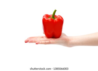 Fresh red sweet pepper or bell peppers in hand of a womam, isolated on white background, copy space.