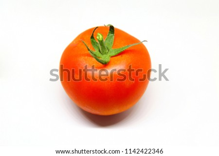 Fresh red tomato isolated over a white background