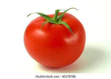 fresh red tomato isolated in a white background