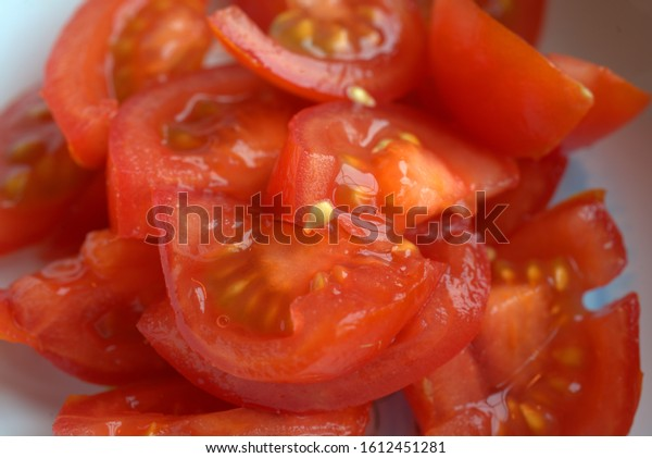 fresh red tomatoes cut into pieces