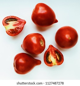 fresh red tomatoes isolated on white background. flat lay