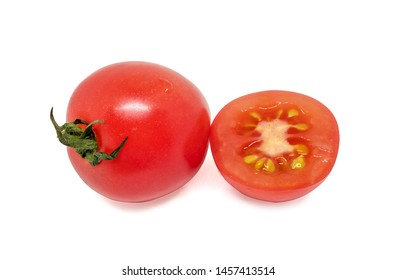 Fresh red Whole and a half tomatoes on white background.