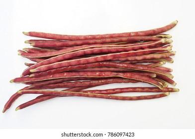 fresh red yard long bean on white background