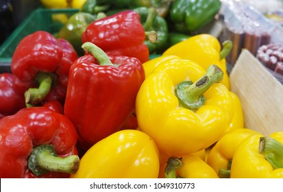 Fresh red, yellow and green  capsicum on display for sale at Kota Kinabalu, Sabah market.