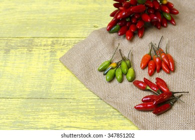 fresh red, yellow and green chilli on old wood background. selective focus image, space for advertising text