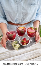 Fresh refreshing cocktails with fruit served on a tray, cranberry coolers sangria mocktails