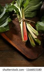 Fresh rhubarb bunch on cutting board