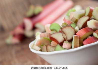 Fresh rhubarb on wooden background. Shallow dof