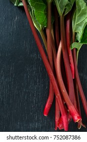 fresh rhubarb on wooden surface