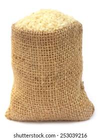Fresh rice in sack bag over white background