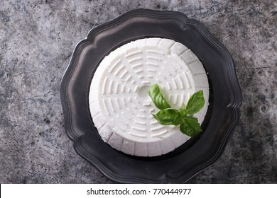 A fresh ricotta with basil leaf on wooden table italian food concept