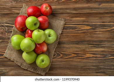 Fresh ripe apples on wooden table