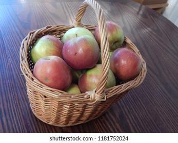 Fresh ripe apples in a wicker basket