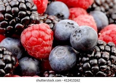 Fresh ripe berries. Blueberry, blackberry, strawberry. Food background. Healthy fruits.