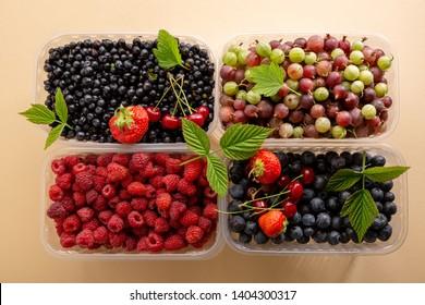 Fresh ripe berries in boxes