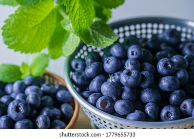 Fresh ripe blueberries in colander.