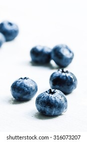 Fresh ripe blueberries on white background, selective focus
