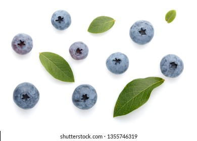 Fresh ripe blueberry berries and leaves isolated on white background. Top view. Flat lay.