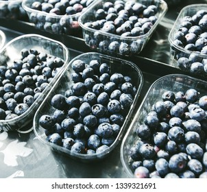 fresh ripe blueberry in plastic box ready for sale at local farmers market stall