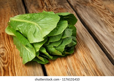 Fresh ripe cabbage on wooden table
