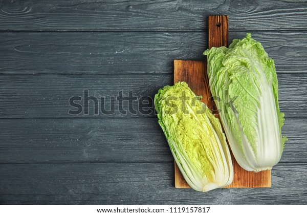 Fresh ripe cabbages on wooden board
