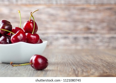 Fresh Ripe Cherries in a White Bowl