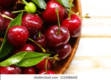 fresh ripe cherry with green leaves, macro shot