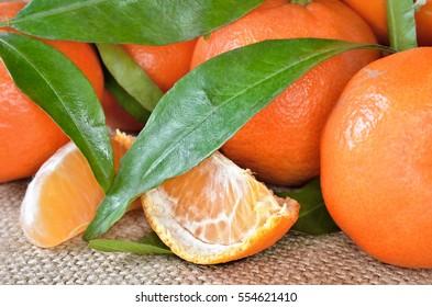 Fresh, ripe citrus, on a rough sacking